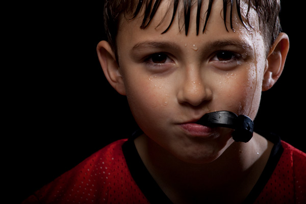 Sweaty boy with a custom mouth guard from Perrinville Family Dentistry in Edmonds, WA