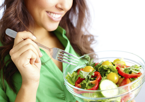 Woman eating healthy after visiting Perrinville Family Dentistry in Edmonds, WA